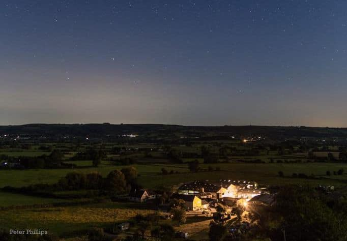 Garden end farm from hill at night